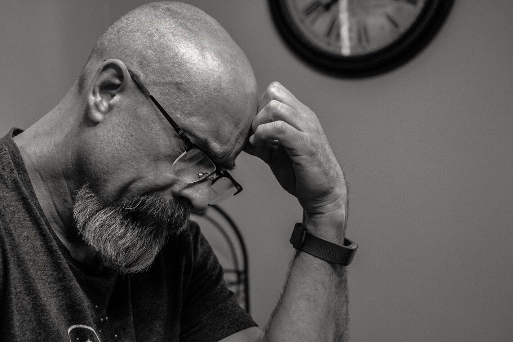 Image of a Man Thinking in Front of Analog Wall Clock, ways to Improve Intrapersonal Communication