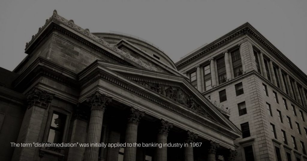 A picture containing a building, outdoor, tall, bank. The history of Disintermediation.